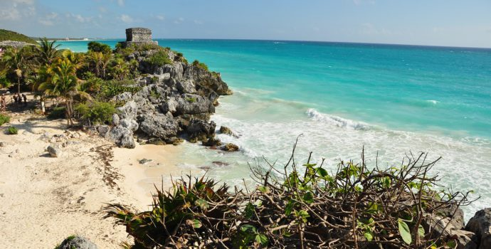 Explore beautiful ruins, perched on a seaside cliff in Tulum