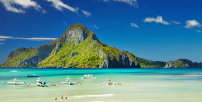 Soak in the unique scenery and towering limestone cliffs of El Nido