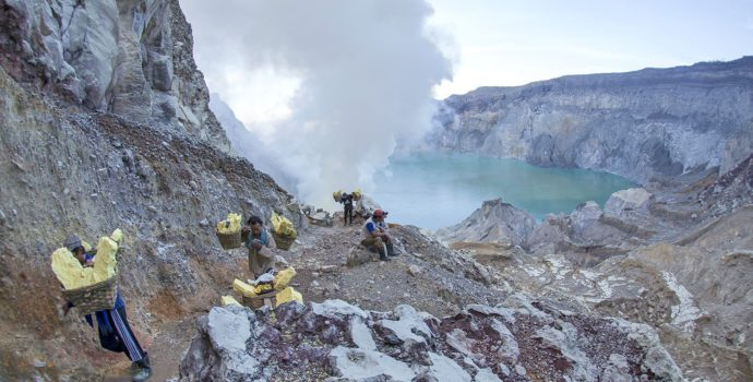 See Ijen Volcano's turquoise crater lake and the sulfur porters hard at work