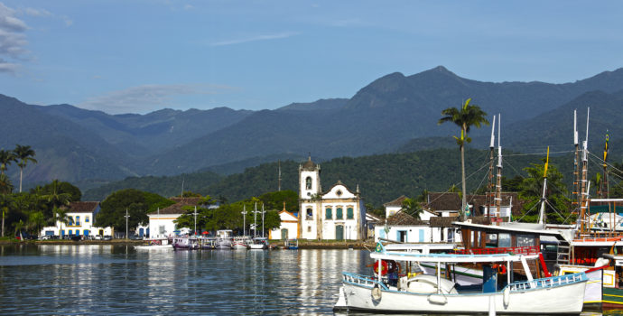 Stroll along the harbour during your walking tour of Paraty